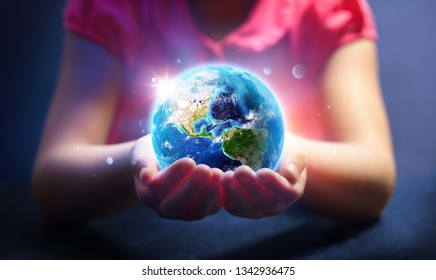 Child Hold World - Magic Of Life - Earth Day Concept - 3d Rendering - Usa elements of this image furnished by NASA