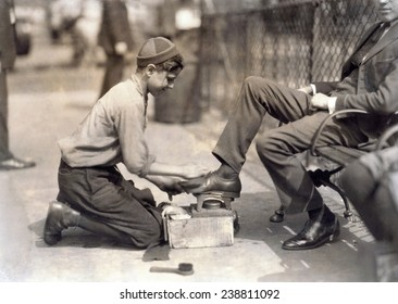 Child labor. Tony, a twelve year old bootblack at his station in Bowling Green, New York City. photograph by Lewis Wickes Hine, July, 1924
