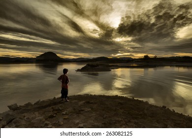 Child looking at a sunset on the marsh. Illustration painting style