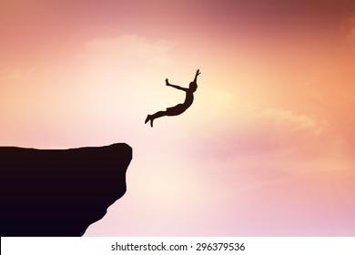 Children jump from a cliff