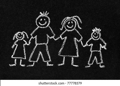 Children's chalk drawing on a blackboard of a happy family with mum, dad, son and daughter