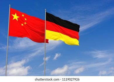 China and Germany flags over blue sky background. 3D illustration