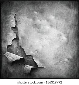 chipped metal plating on scratched wall , grunge background