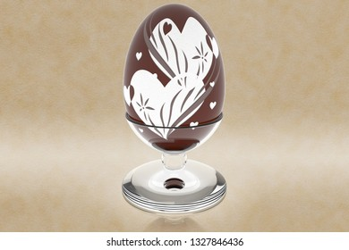 Chocolate Easter egg decorated, with glass holder, isolated on parchment background.
