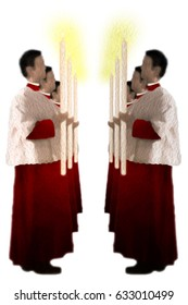 Christian catholic altar boys or servers in red cassock and white surplice, carrying a lit candle