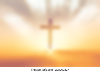Christian concept: Blurred silhouette cross on Golgotha mountain with autumn sunset sky background