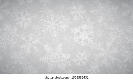 Christmas background of many layers of snowflakes of different shapes, sizes and transparency. White on light gray.