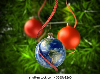 Christmas ball Globe on Christmas tree. Elements of this image furnished by NASA