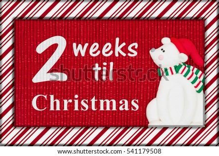 christmas countdown message red shiny fabric with a candy cane border and a santa polar