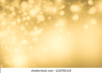 Christmas glowing Golden Background. Christmas lights. Gold Holiday New year Abstract Glitter Defocused Background With Blinking Stars and sparks. Blurred Bokeh.