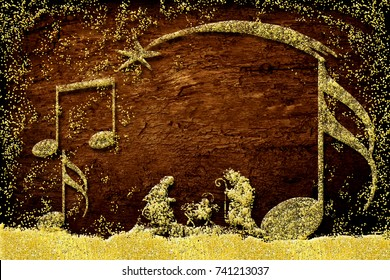 Christmas  greetings cards, abstract freehand drawing of Nativity scene and music notes with gold glitter on wooden background