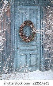 Christmas holiday background with barn door and wreath/ digital painting