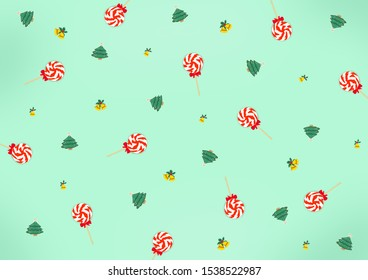 Christmas holidays composition Top view of Cookie Christmas tree decoration, lollipop candy and yellow bell on green pastel background with copy space for text