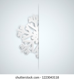 Christmas illustration with one white big snowflake which protrudes from the cut on a light blue background