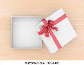 Christmas and New Year's Day ,Open red gift box top view on table background 3d rendering