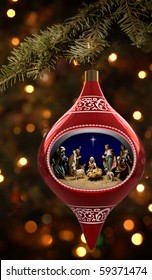 Christmas ornament featuiring a diorama of the nativity