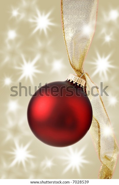 christmas ornament with twinkling lights - gold background