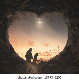 Christmas religious nativity story concept: Silhouette Jesus born in birth manger with heart shape of tomb stone on star of cross