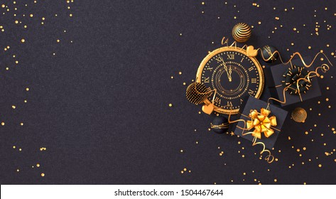 Christmas shiny black background, New Year, black box, clock,gold bow, flying confetti, clock, sparkles, tinsel, balls, heart, toys, ball, serpentine, garland illumination, 3D rendering,