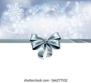 Christmas snowflakes and bow ribbon silver abstract Christmas background. White at the bottom and side for easy use as header.
