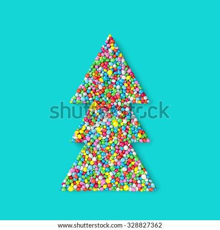 christmas tree coated with nonpareils of different colors isolated on turquoise background
