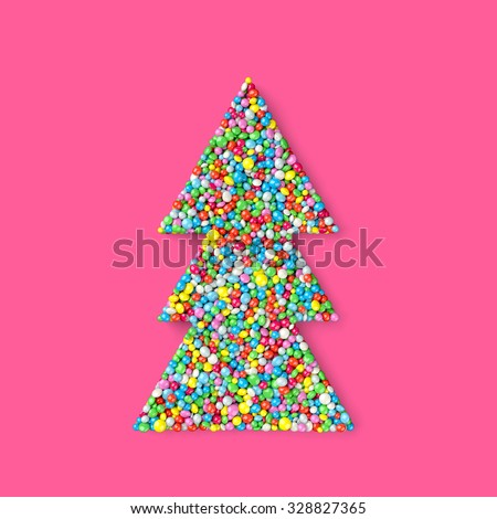 christmas tree coated with nonpareils of different colors isolated on pink background