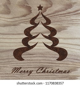 Christmas tree engraved on wood with pyrography technique. Hobby. DIY. Do it yourserlf