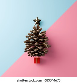 christmas tree made of set of gold star ,pine-cone and red gift on light-blue and pink pastel background for minimal celebration concept. 3d illustration