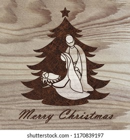 Christmas tree with nativity scene engraved on wood with pyrography technique. Hobby. DIY. Do it yourserlf