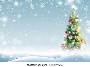 Christmas tree with snow falling in winter