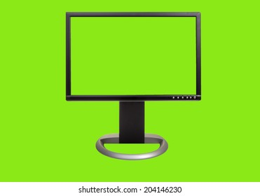 A chroma key green screen computor monitor, front view, with easy to remove background and copy space for your use. Isolated on green.