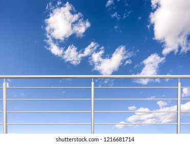chrome , stainless steel fence, inox fence or alu fence. aluminum fence with clouds sky background. 3D illustration