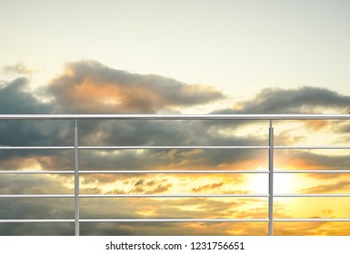 chrome , stainless steel , inox or alu fence. aluminum fence with sunset clouds sky background. 3D illustration