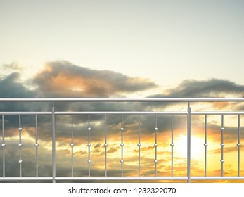 chrome , stainless steel  inox fence or alu fence. aluminum fence with sunset clouds sky background. 3D illustration