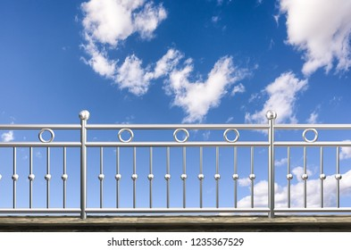 chrome, stainless steel, inox fence or alu fence. aluminum fence with clouds sky background. 3D illustration