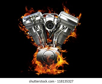 Chromed motorcycle engine on fire on a black background