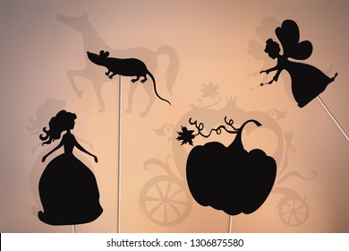 Cinderella fairy tale. Shadow puppets of Cinderella, fairy godmother, pumpkin and mouse, shadows of magic carriage and horse.