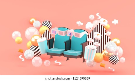 Cinema chair Soft drinks and popcorn among the colorful balls on the pink background.-3d rendering.