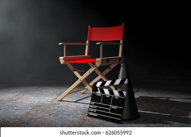 Cinema Industry Concept. Red Director Chair, Movie Clapper and Megaphone in the volumetric light on a black background. 3d Rendering.
