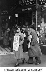 CIO (Congress of Industrial Organizations) strikers pickets a store in the Yorkville neighborhood of Manhattan. Dec. 1937.