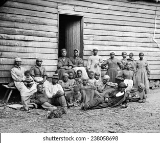 The Civil War, African American 'contrabands' (escaped slaves), at Foller's house, Cumberland Landing, Virginia, by James F. Gibson, 1862.