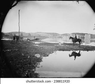 The Civil War. The Battle of Antietam. Pontoon bridge and ruins of the stone bridge across the Potomac River, Berlin, Md. Photograph by Alexander Gardener. 1862