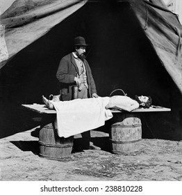 The Civil War, embalming surgeon at work on soldier's body, photograph, 1860-1865