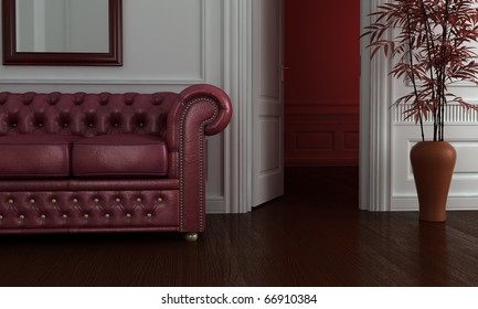 Classic clean interior with burgundy leather sofa.