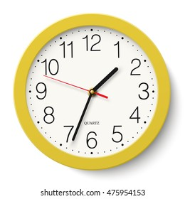 Classic round wall clock in yellow body isolated on white