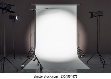 Clean photo studio with professional lighting equipment and white background. Photgraphy concept. Mock up, 3D Rendering