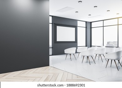 Clean presentation auditorium with chairs, empty white screen and blank gray wall. Conference and presentation concept. Mock up. 3D Rendering