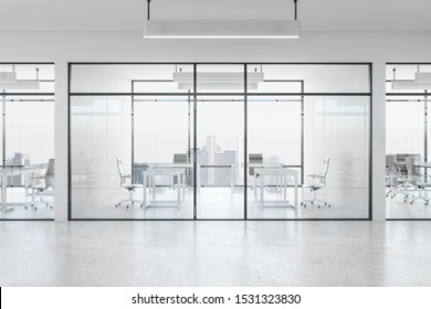 Clean white office interior with glass, furniture, city view and daylight. 3D Rendering