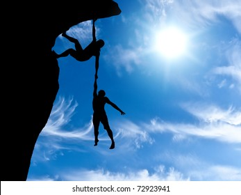 climber clings to a rock plummet with the other hand holding the man