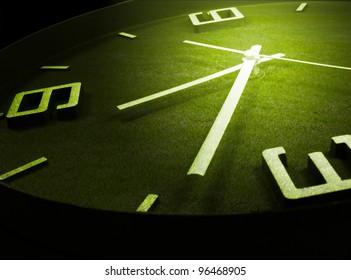 clock and green grass